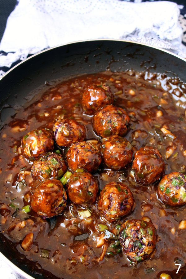 Dry Veg Manchurian Recipe - Small veggie balls dipped in thick gravy made with garlic, ginger, chilli and soya sauces.
