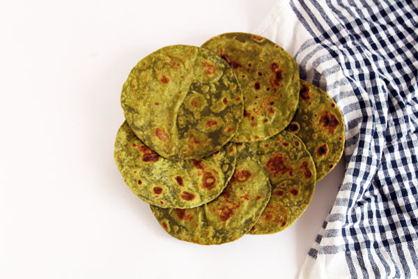 Palak Parahta OR Spinach Paratha - Indian flat bread (roti) prepared from whole wheat flour, spinach puree, garlic and salt.