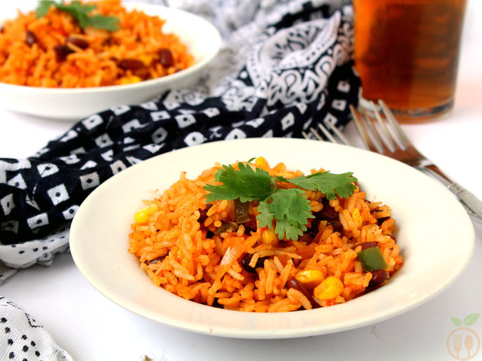 Veg Mexican Fried Rice - Cooked rice tossed with kidney beans, corns, peppers and seasoned with some ordinary spices like salt and cayenne pepper powder.