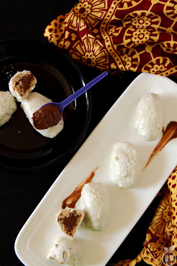 White Chocolate Truffles stuffed with Peanut & Coconut - Chocolate mixed Peanut and coconut bars covered with white chocolate.